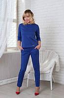 Модный женский костюм синего цвета