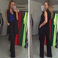 Женский костюм из костюмной ткани. Доступен в разных цветах. Размеры XS, S, M, L.