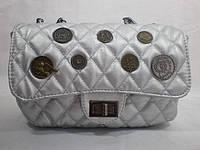 Стильная вместительная сумочка на цепочке