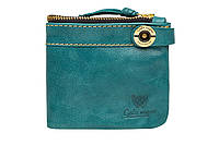 Женский кошелек зеленого цвета.
