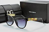 Солнцезащитные очки круглые Dolce & Gabbana черные с золотом