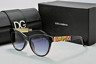 Солнцезащитные очки круглые Dolce & Gabbana черные с цветной оправой