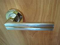 Ручка дверная Doganlar Stripon roz золото + сатин