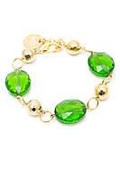 Стильный браслет на золотистой цепочке с камнями зеленого цвета