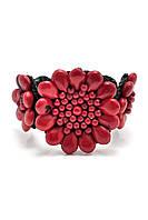 Браслет с красным камнем в форме цветка