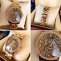 Часы Guess 114612 женские золотистый корпус циферблат в камнях