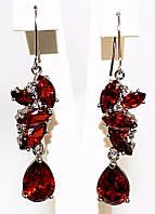 Серьги вечерние.Камень: бордовый циркон. Высота серьги: 5,5 см. Ширина: 12 мм.