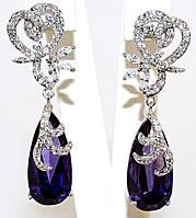 Серьги вечерние.Камень: фиолетовый  циркон. Высота серьги: 4,5 см. Ширина: 13 мм.