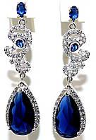 Серьги вечерние.Камень:  белый и синий  циркон. Высота серьги: 5,5 см. Ширина: 15 мм.