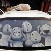 Реклама на заднем стекле авто