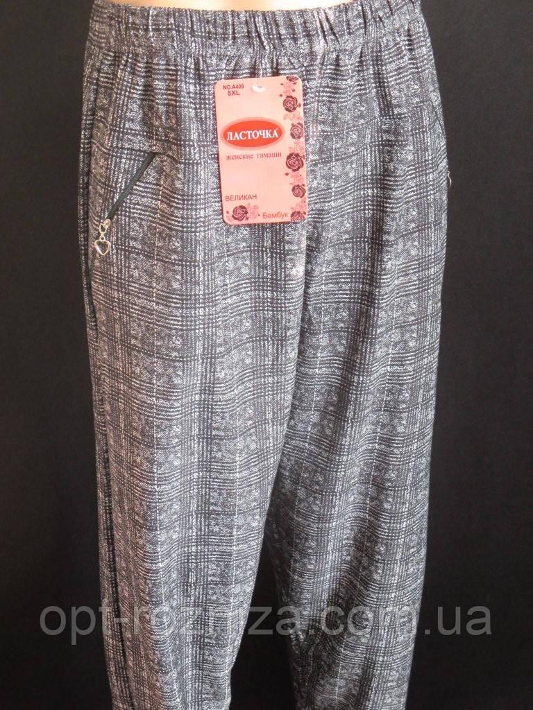 Клетчатые брюки женские с карманами на молнии