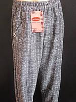 Клетчатые брюки женские с карманами на молнии, фото 1