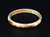 Тонкий браслет из кости и металла