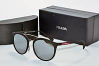 Солнцезащитные очки круглые Prada черные матовые