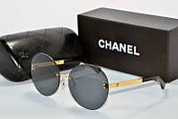 Солнцезащитные очки круглые Chanel черные с золотом