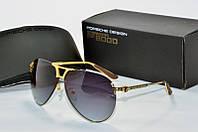 Солнцезащитные очки  Porsche Design черные с золотом