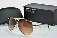 Солнцезащитные очки  Porsche Design коричневые с золотом