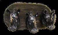 Горельеф - три носорога