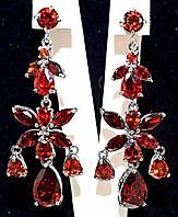 Серьги вечерние.Камень:бордовый циркон. Высота серьги: 5,5 см. Ширина: 20 мм.