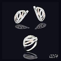Серебряные серьги и кольцо с золотыми напайками.
