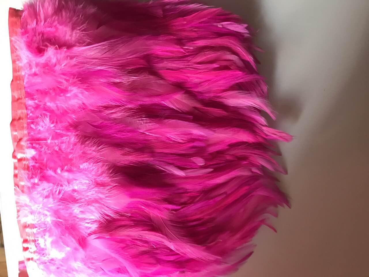 Пір'яна тасьма з пір'я півня.Колір на рожевий.Ціна за 0,5 м