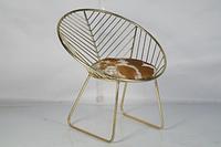 Железный стул-кресло с кожаной сидушкой, круглой формы. Цвет brass antique. Ручная работа. Сделано в Индии.