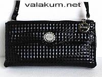 Женская черная сумочка-клатч.