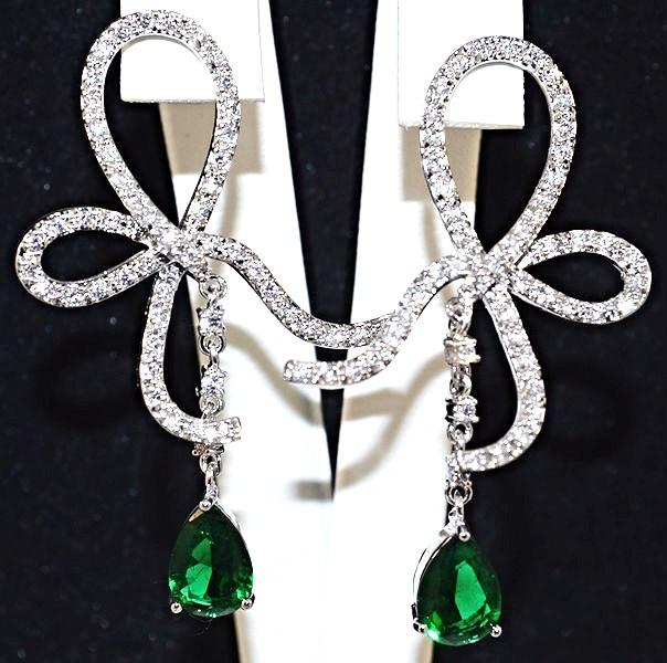 Серьги вечерние.Камень: зелёный и белый циркон. Высота серьги: 5 см. Ширина: 33 мм.