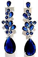Серьги вечерние.Камень: синий циркон. Высота серьги: 6,3 см. Ширина: 14 мм.