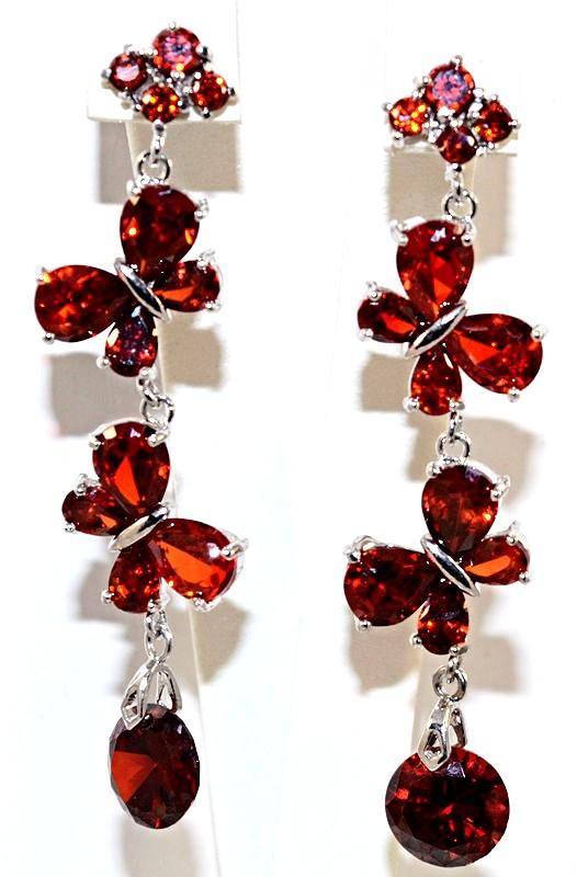 Серьги вечерние.Камень: бордовый циркон . Высота серьги: 6,5 см. Ширина: 15 мм.