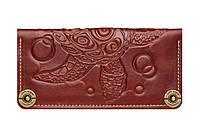 Зручний жіночий гаманець з безліччю відділень.