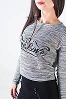 Модная женская трикотажная кофточка с удлиненной спинкой