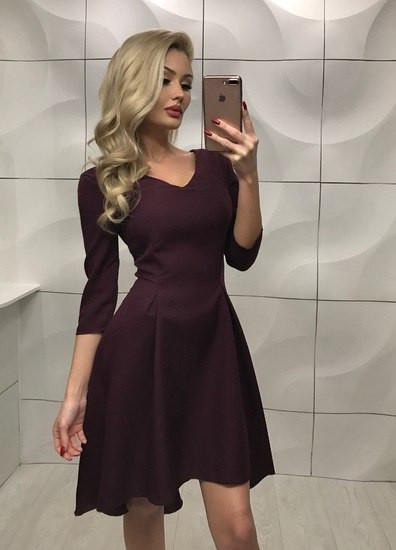Платье асимметричное,короткое спереди и удлененое сзади