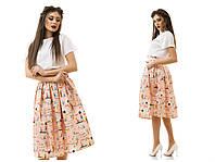 Романтичный женский костюм из клешеной юбки миди и белой блузки