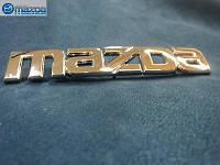Mazda 3 2004-09 седан эмблема значок надпись шильдик на багажник Новый Оригинал