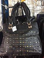 Женская стильная сумка с тиснением.