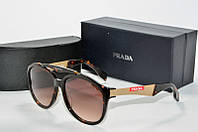 Солнцезащитные очки круглые Prada коричневые