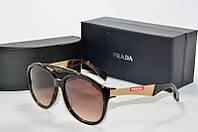 Солнцезащитные очки круглые Prada коричневые, фото 1