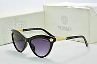 Солнцезащитные очки Versace черные