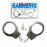 Металлические наручники.