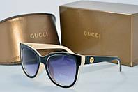 Солнцезащитные очки круглые Gucci черные с бежевым