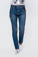 Женские синие джинсы с эффектом потертости