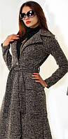 Асимметричное женское пальто приталенного фасона под пояс с отложным воротником и накладными карманами букле