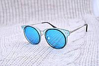 Стильные очки с бирюзовой линзой