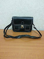 Стильная женская сумочка-клатч черного цвета