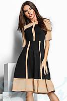 Расклешенное двухцветное платье. Цвет черно-бежевый.