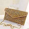 Бежево-золотистая женская кожаная сумка