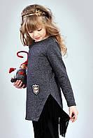 Асимметричная детская трикотажная туника для девочки украшена оборкой из фатина