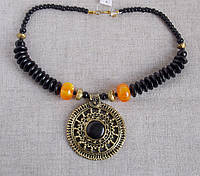 Колье в этностиле с медальоном из латуни