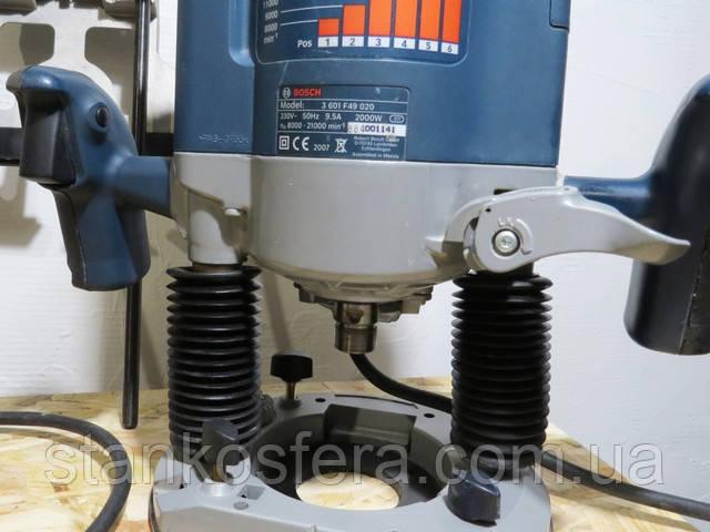 Отключение фиксатора вертикального хода фрезера Bosch GOF 2000 CE
